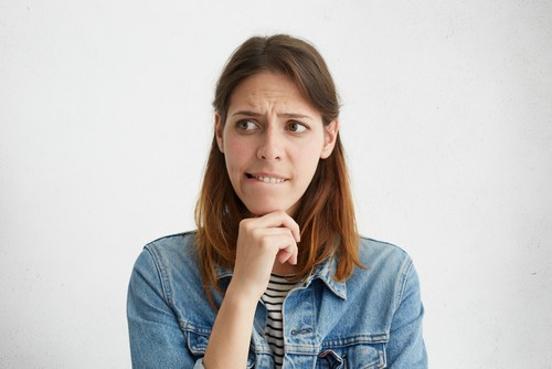 woman bites lip